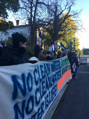 Anti-pipeline protesters stand outside the Stonewall Jackson Hotel and Conference Center on Sunday, October 21, 2018 for the opening night of the Governor's Summit on Rural Prosperity.
