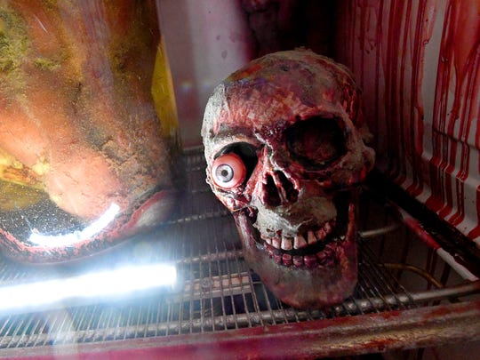What appears to be a skull with one eye is among decorations inside Madame Redrum's Nine Gates of Doom haunted house, based in the 18th century Coiner's Mill in Waynesboro.