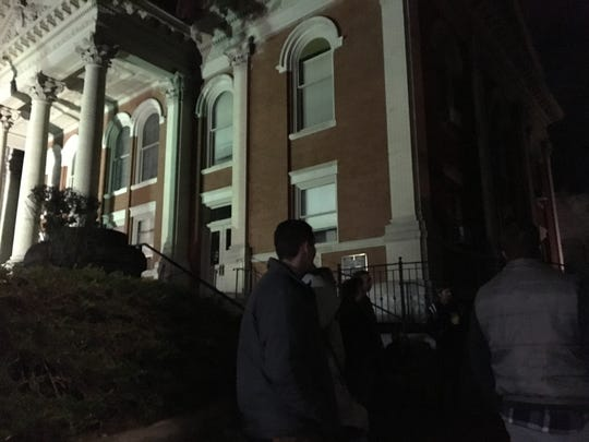 Dark Staunton tour participants stand outside of the Staunton Courthouse as they learn of the building's dark history.