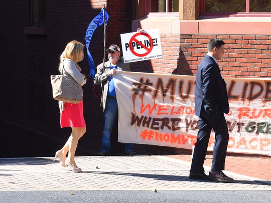 A group of nine anti-pipeline protestors confront attendees of the Governor's Summit on Rural Prosperity as they walk from the Stonewall Jackson Hotel and Conference Center to Blackfriars Playhouse in Staunton on Monday, Oct. 22, 2018.