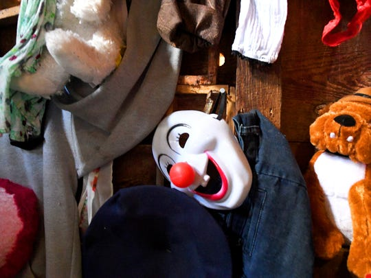 A mask among decorations inside Madame Redrum's Nine Gates of Doom haunted house, based in the 18th century Coiner's Mill in Waynesboro.