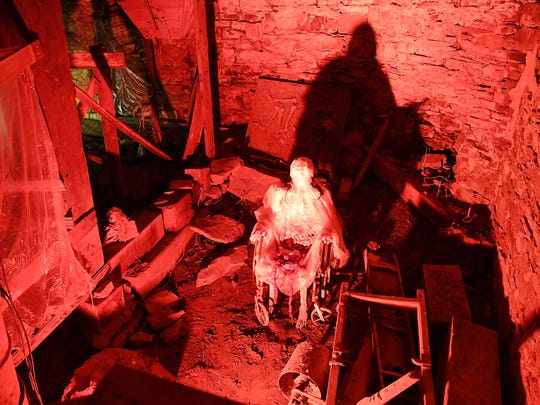 A small part of one scene set for an evening of haunts and scares inside Madame Redrum's Nine Gates of Doom haunted house, based in the 18th century Coiner's Mill in Waynesboro.