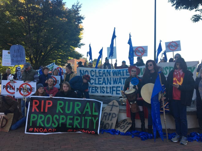About 60 anti-pipeline protestors gathered at the Wharf parking lot in downtown Staunton on Sunday, October 21, 2018, before marching to the Stonewall Jackson Hotel and Conference Center for opening night of the Governor's Summit on Rural Prosperity.