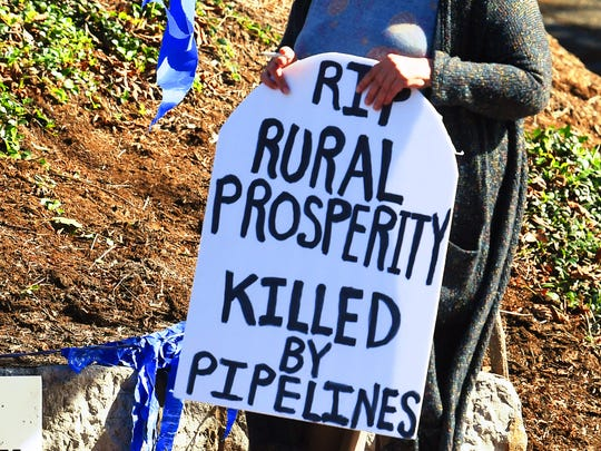 Anti-pipeline protestors arrive across the street from the Stonewall Jackson Hotel and Conference Center on the second day of the Governor's Summit on Rural Prosperity in Staunton on Monday, Oct. 22, 2018.
