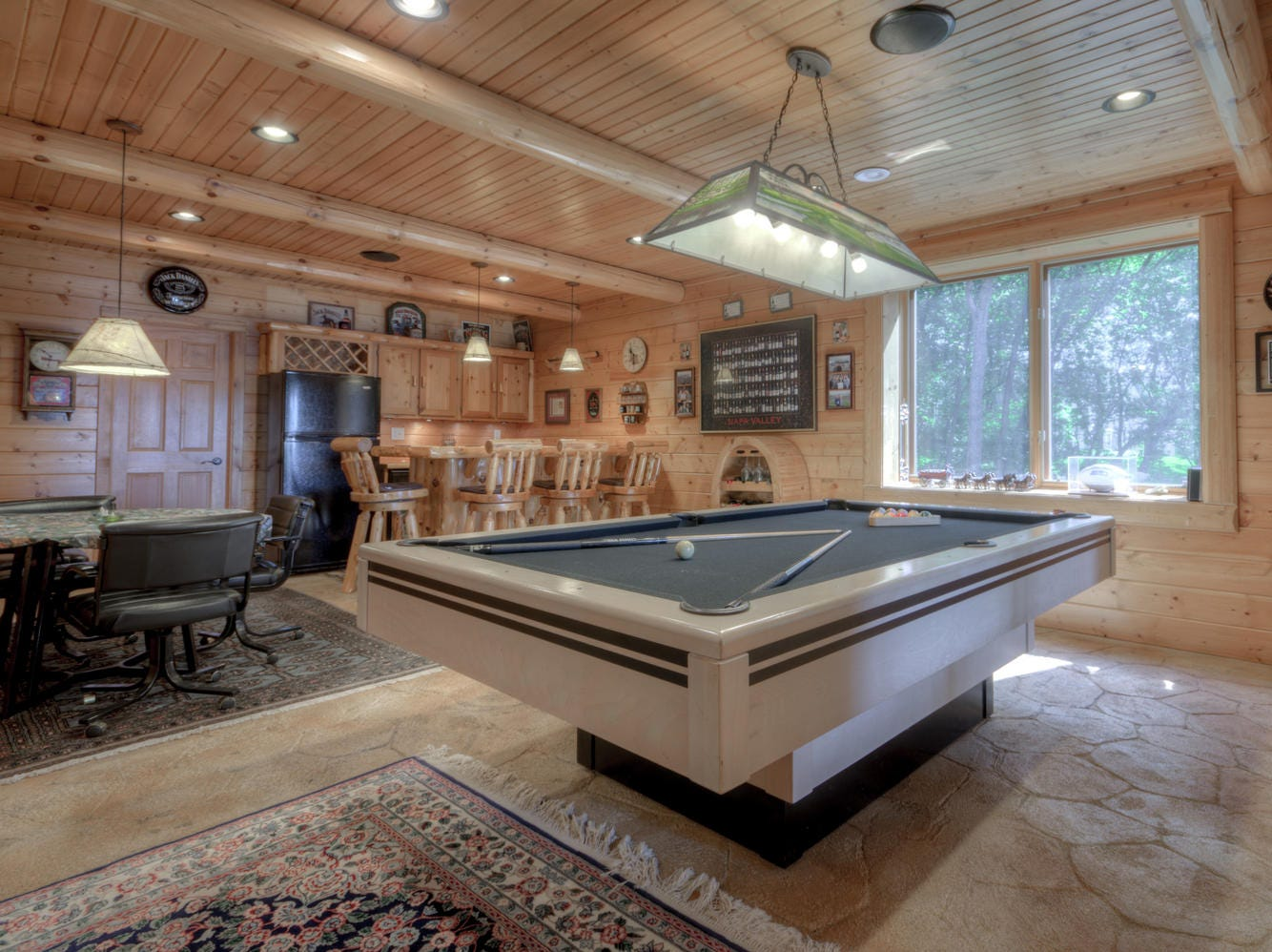 The lower level boasts a large recreational/billiards room as well as a wet bar for entertaining guests lakeside.