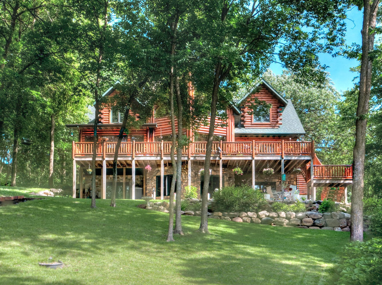This 4,000-square-foot log home sits onLouisa Lake in South Haven.