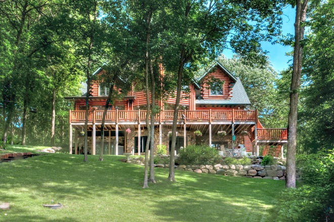 This 4,000-square-foot log home sits on Louisa Lake in South Haven.