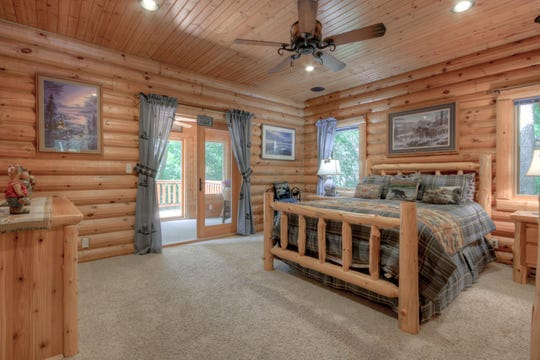 The master bedroom suite sits on the first floor and features a private sun porch and walk-in closet.