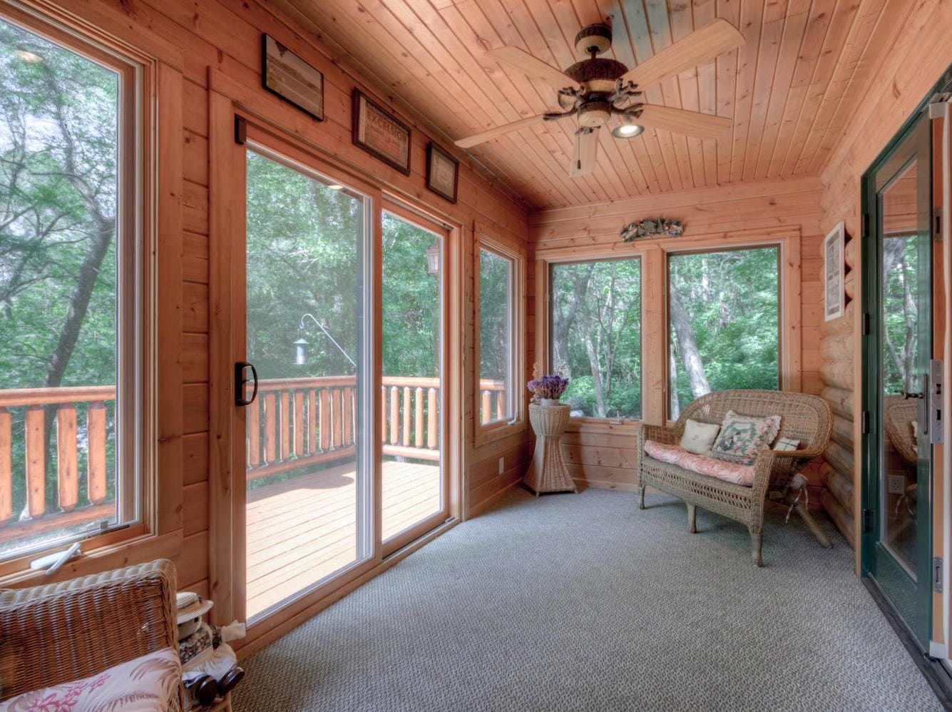 The master bedroom suite features a private sun porch.