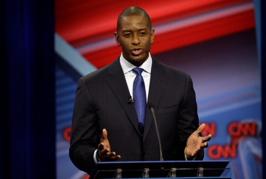 Florida Democratic gubernatorial candidate Andrew Gillum speaks during a CNN debate against Republican gubernatorial candidate Ron DeSantis, Sunday, Oct. 21, 2018, in Tampa, Fla. (AP Photo/Chris O'Meara)