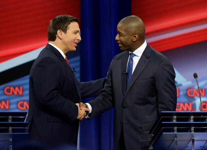 Florida gubernatorial candidates, Republican Ron DeSantis, left, and Democrat Andrew Gillum meet after a CNN debate, Sunday, Oct. 21, 2018, in Tampa, Fla. (AP Photo/Chris O'Meara)