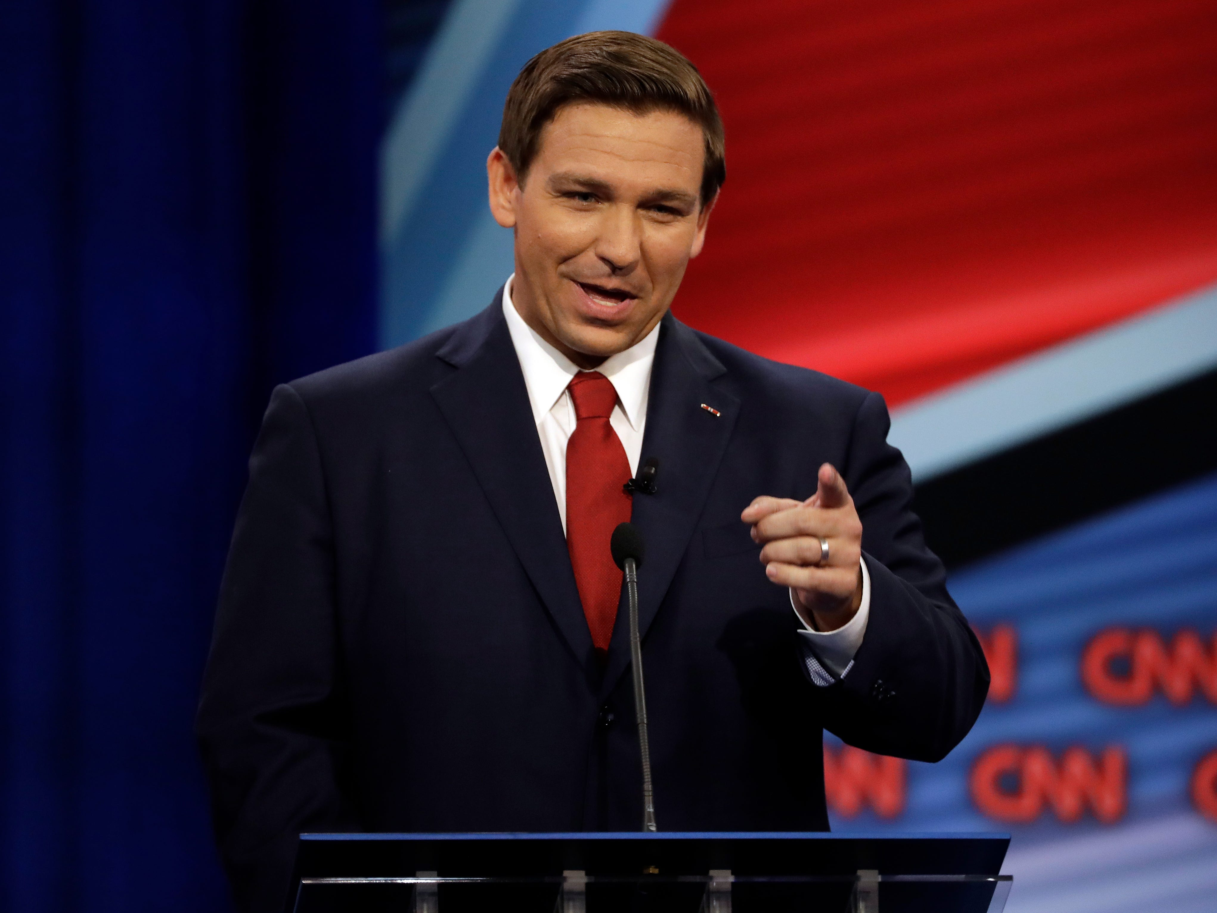Florida Republican gubernatorial candidate Ron DeSantis speaks during a CNN debate against opponent Democratic gubernatorial candidate Andrew Gillum, Sunday, Oct. 21, 2018, in Tampa, Fla. (AP Photo/Chris O'Meara)