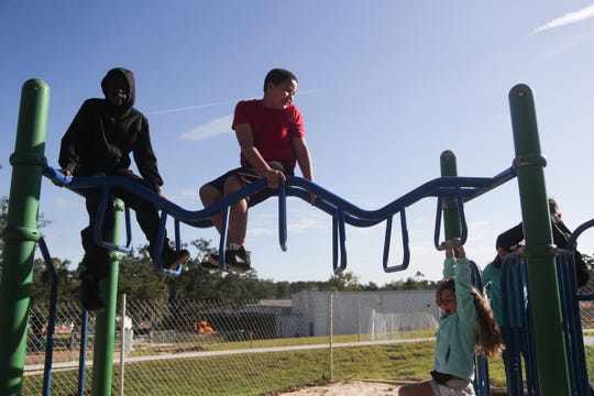 W.T. Moore Elementary School students play on their playground. A local company is offering a structure giveaway.