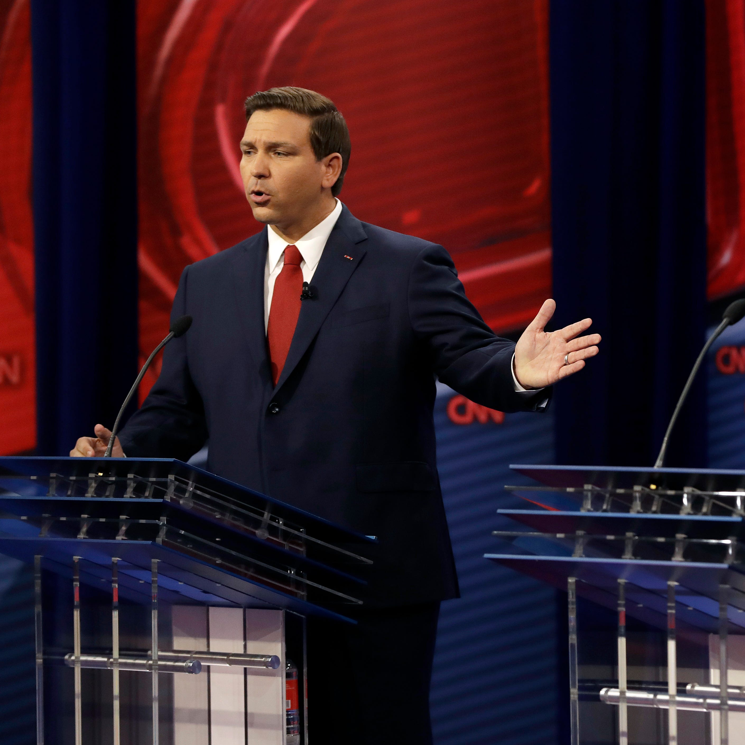 Ron DeSantis, Andrew Gillum fight over Trump and more in Florida debate on CNN