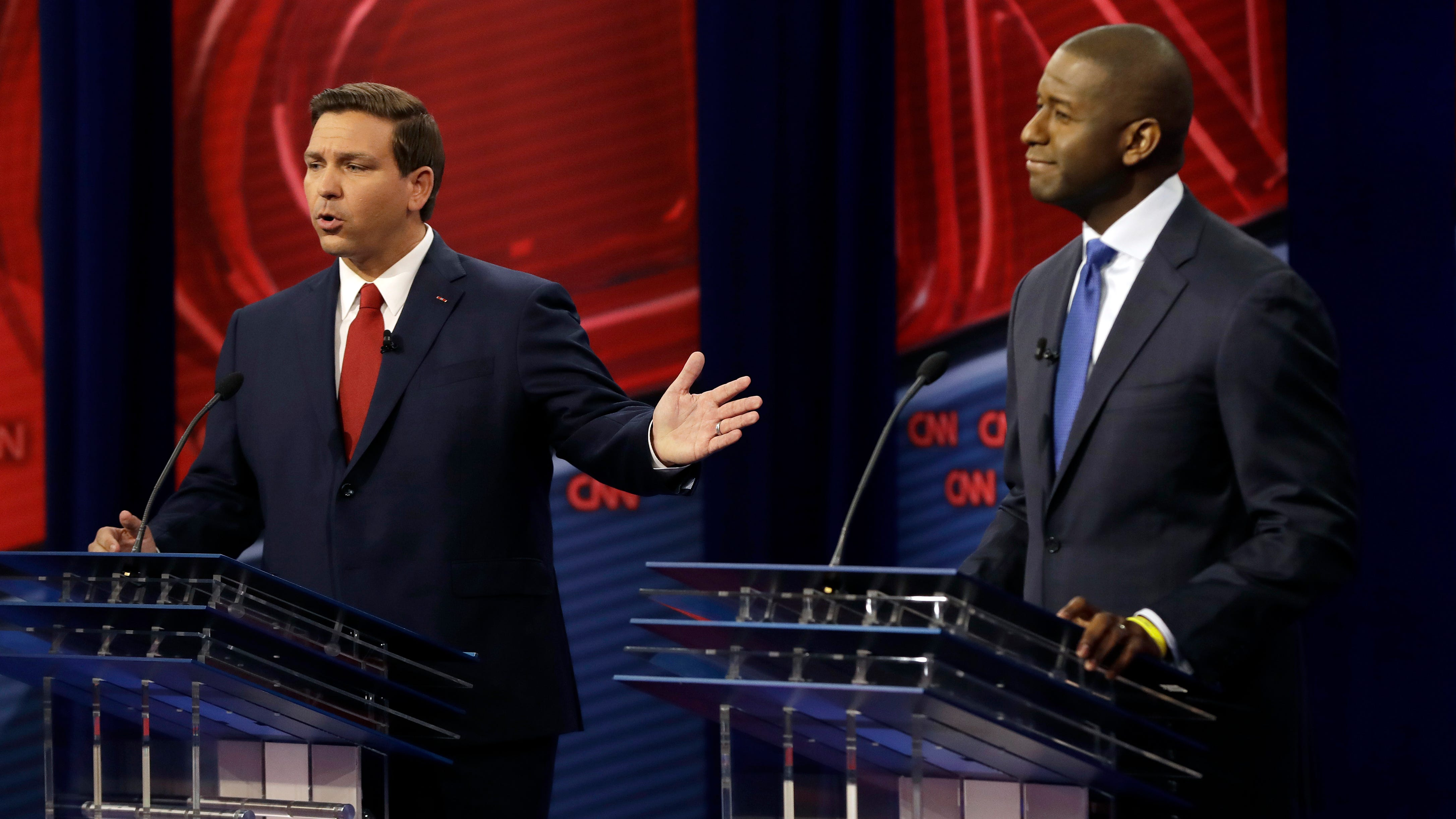 Florida Republican gubernatorial candidate Ron DeSantis, left, speaks about his Democratic opponent Andrew Gillum during a CNN debate, Sunday, Oct. 21, 2018, in Tampa, Fla. (AP Photo/Chris O'Meara)