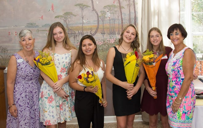 """Laura Elsenboss, chair of the Stuart Woman's Club's """"Art is Everywhere Tour,"""" presented scholarships to arts students Keana McArdle, Alexandra Trejo, Lillie Schaff and Kayla Dunnuck, with Janie Copes, club president."""