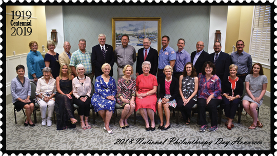Pictured are some of the 2018 National Philanthropy Day honorees, front row, from left: Robbie Sexton, Mary Ellen Replogle, Christine Walker, Karla Spooner, Trudie Rainone, Joan Woodhouse, Sandy Rolf, Langie Mannion, Rebecca Schlitt, Joyce Desrosiers, Sheila Marshall and Isabel Ernst. Back row: Nancy Hopwood, Nancy Luther, Dale Jacobs, Charles Brashears, Jeff Smith, Rodger Pridgeon, Randy Rolf, J.W. Colontrelle, Durga Das Hutner, Al DeRenzo, Timothy Straley and Bill Marine.