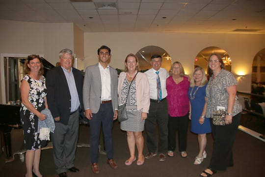 Members of the Education Foundation of Indian River County share a moment with inventor Omar Shareef. Pictured are, from left, Lisa Presti, Brian Mayo, Shareef, Cynthia Falardeau, Pat and Peggy Hiser, Cathy Filusch and Heather Holden.