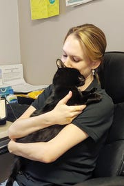 Humane Society Volunteer Program & Mobile Adoption Coordinator Sarah Fisher gets a daily hug from Sparta.