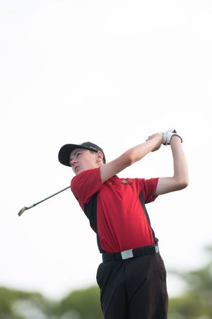 Port St. Lucie's Fletcher Wunderlich watches his tee shot on the 6th hole during the high school Region 8-2A boys and girls Golf Championship at Sandridge Golf Club on Monday, October 22, 2018 in Vero Beach.