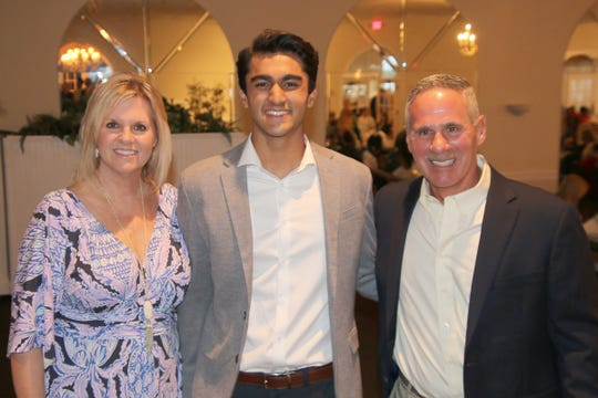 """Dana and Paul Trabulsy with Omar Shareef, center, at the """"Dinner in Darkness""""event at Fort Pierce'sPelican Yacht Club."""