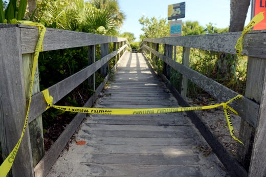 Yellow Barrier blocked one of the entrances to Pepper Park Beach at St. Lucie County on Monday, October 22, 2018 as Beaches on North Hutchinson Island, including Fort Pierce Inlet State Park and Avalon Beach, are closed due to complicatio ns of red tide. The Indian River County beaches are also closed to swimmers due to the tides.