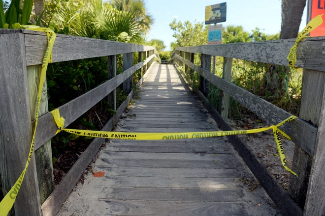 Yellow caution tape blocks one of the entrances to Pepper Park Beach in St. Lucie County on Monday, Oct. 22, 2018 as beaches on North Hutchinson Island, including Fort Pierce Inlet State Park and Avalon Beach, are closed due to complications from red tide. Indian River County beaches are also closed to swimmers due to red tide conditions.