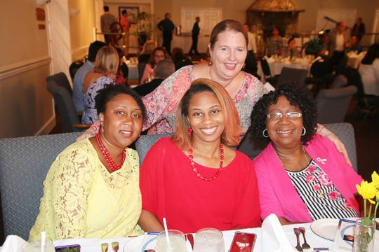 """Valerie Tomlinson, left, Shelita Lammers, Stephanie Labaff and Olivia Watkins at the """"Dinner in Darkness""""event at Fort Pierce'sPelican Yacht Club."""