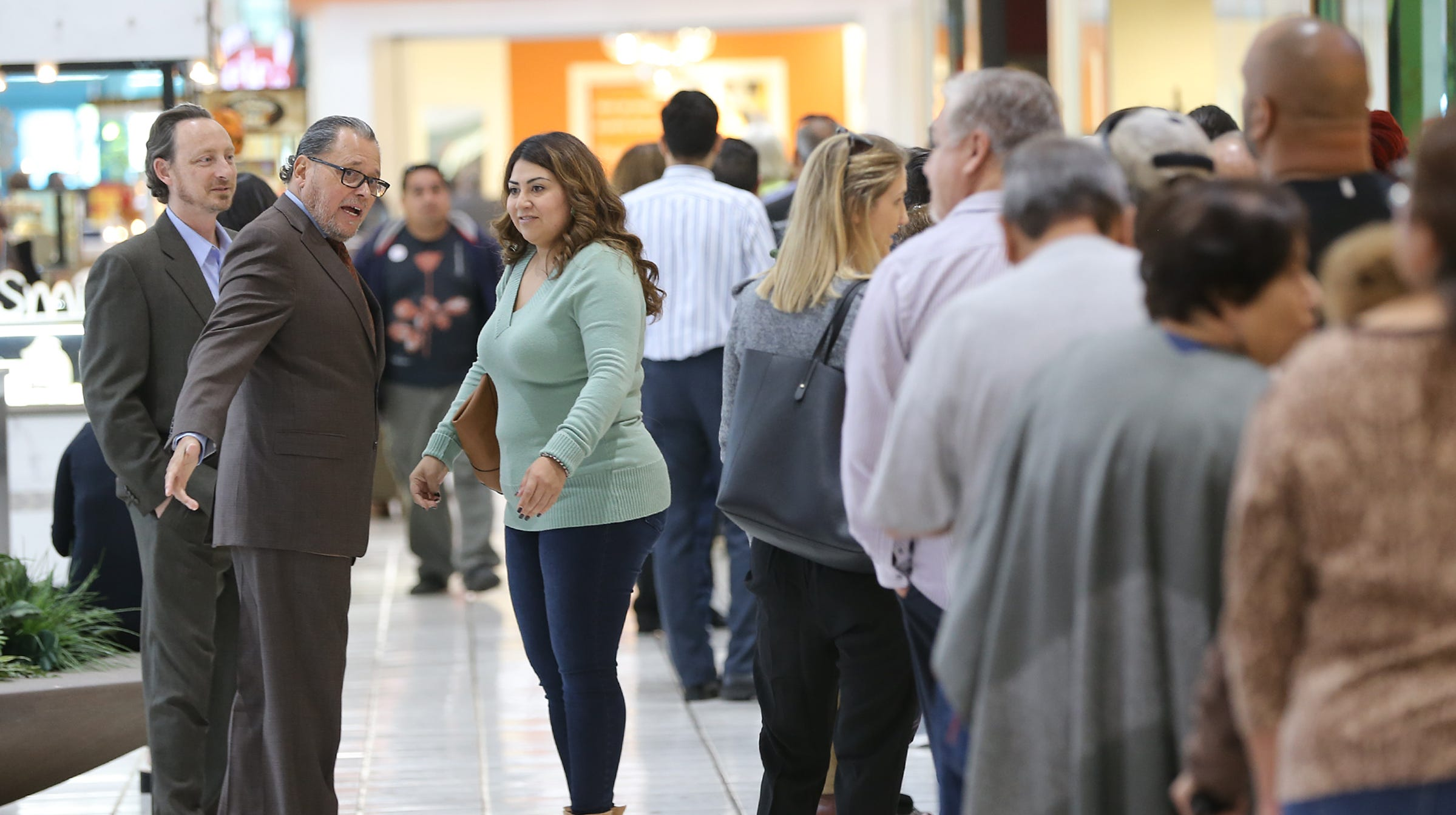 State Senator Jose Rodriguez arrives to long lines at the early voting station at Bassett Place Monday.