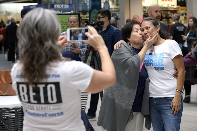 Isabel Escobar kisses her daughter Veronica Escobar outside the early voting station at Bassett Place. Escobar is running for the U.S. Rep seat left vaacant by Beto O'Rourke.