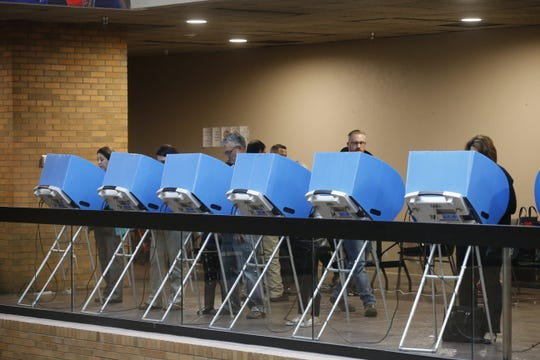 Early voting booths were full, and lines formed throughout the day at the El Paso County Courthouse on the first day of early voting last October.