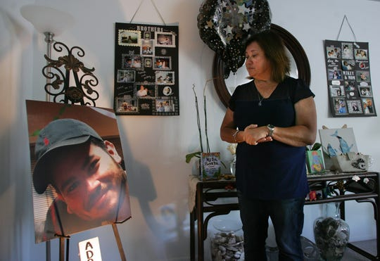 """Connie Hough remembers her late son Adrian """"Mikey"""" Ornelas, 26, as she stands next to his urn and pictures. He was killed May 20 in Oxnard near Bard Road and Anchorage Street."""