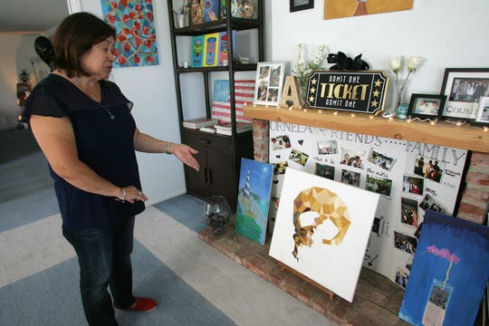 """Connie Hough shows the art work of her late son Adrian """"Mikey"""" Ornelas, 26. He was killed May 20 in Oxnard near Bard Road and Anchorage Street."""
