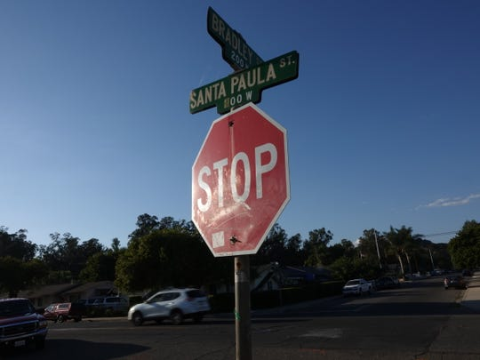 A stop sign on Bradley Street at Santa Paula Street in Santa Paula, where a fatal crash took place near the intersection Saturday night.