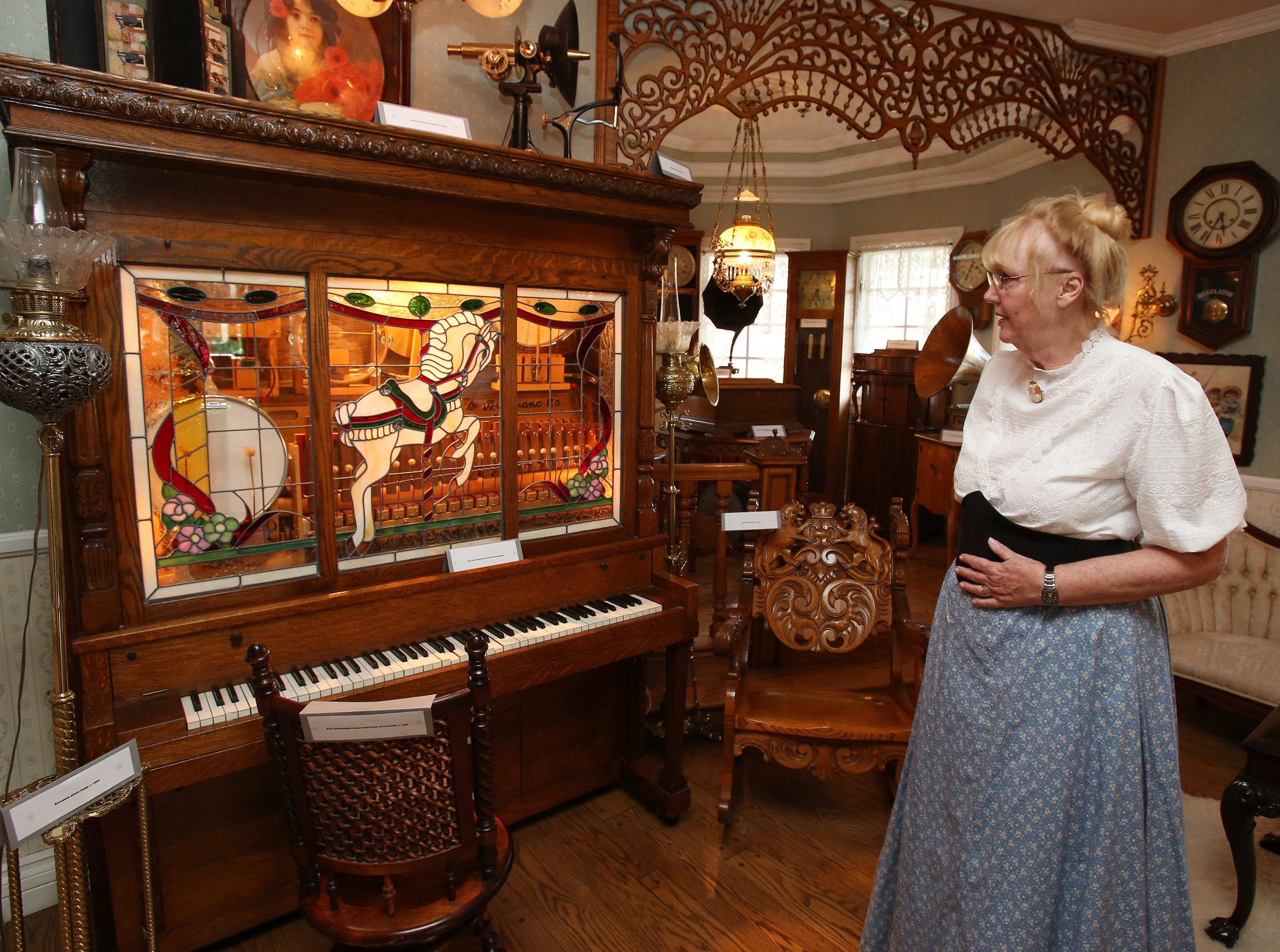 Lorraine Newlon shows the 1910 piano that was converted into a Nickelodeon during a tour of her home in Santa Rosa Valley.