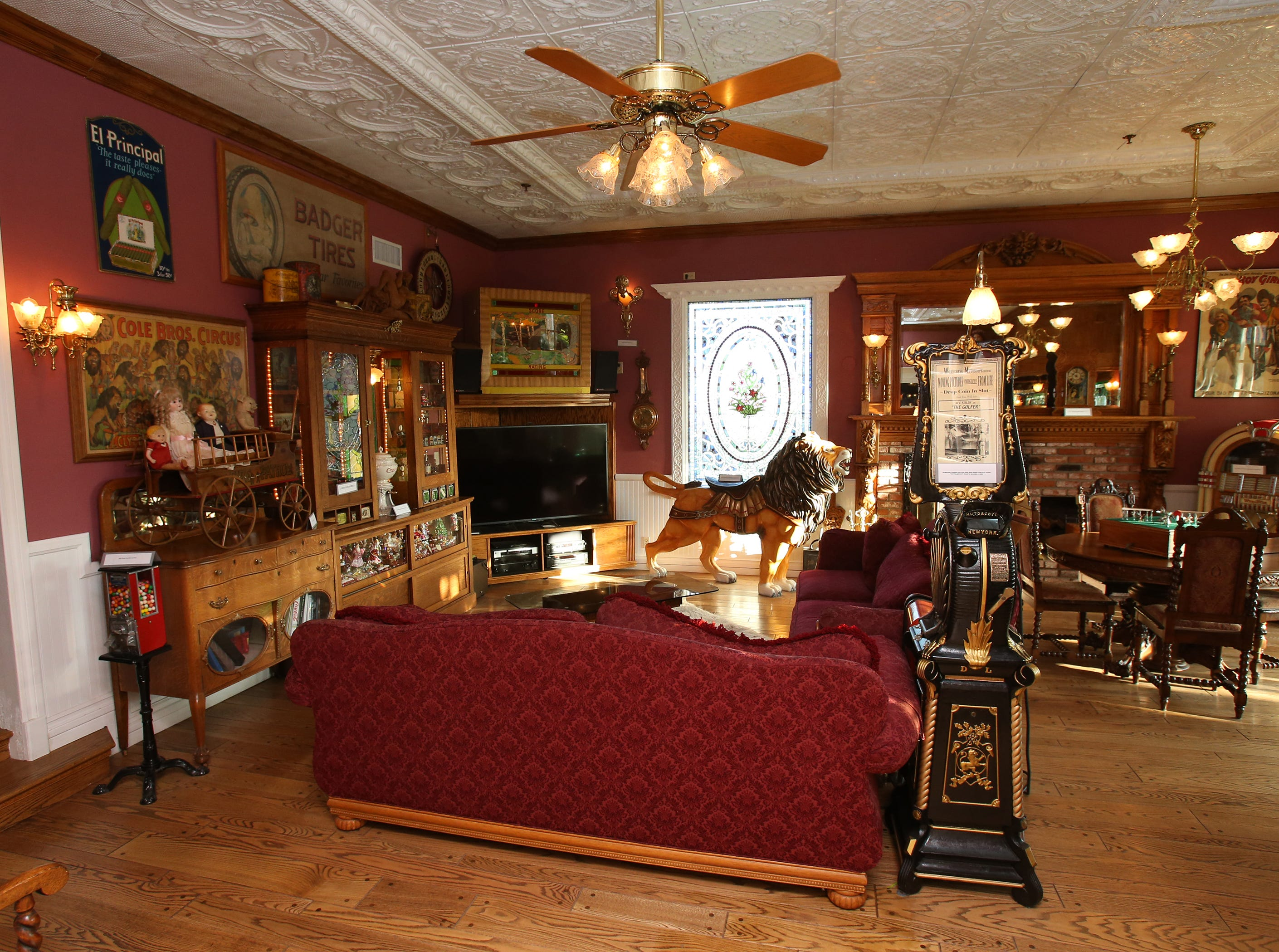 The game room inside the home of Mike and Lorraine Newlon is furnished with antique games and memorabilia, including a carousel lion that was hand-carved from a solid piece of basswood that the couple purchased from the widow of a Newbury Park wood carver.