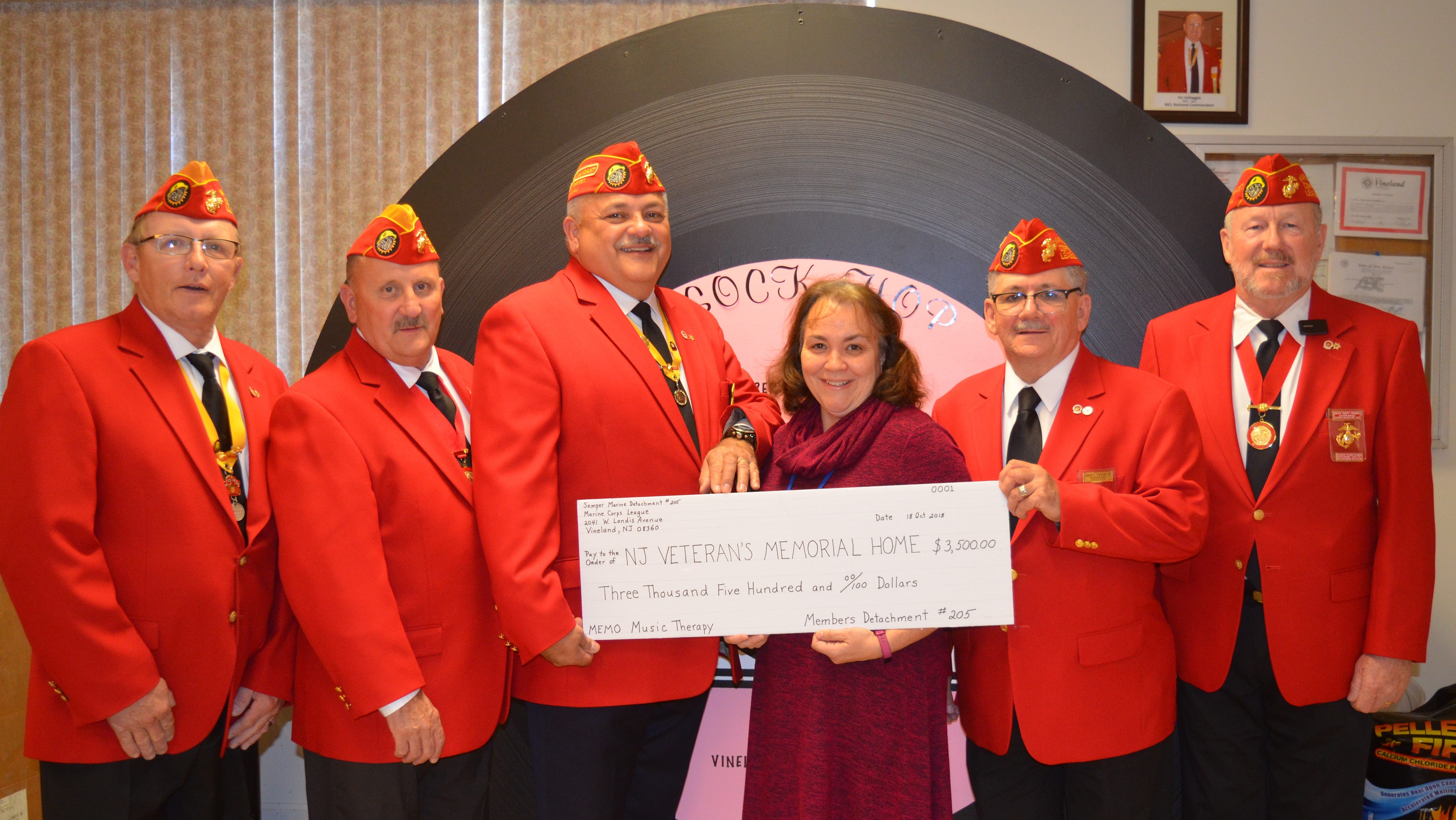 (From left) Dominic Shterban, State Assistant District Vice; Dewey Capriotti, State District Vice; Ed Alicea, Detachment Past Commandant; Lisa Williams, director, volunteer services, New Jersey Veterans Memorial Home; Robert Tesoroni Jr., Sergeant at Arms; and Rusty Hughes, Detachment Security Officer, gathered for the presentation of proceeds, $3,500, from the Sock Hop held by Semper Marine Detachment No. 205, Vineland, to the New Jersey Veterans Memorial Home in Vineland.