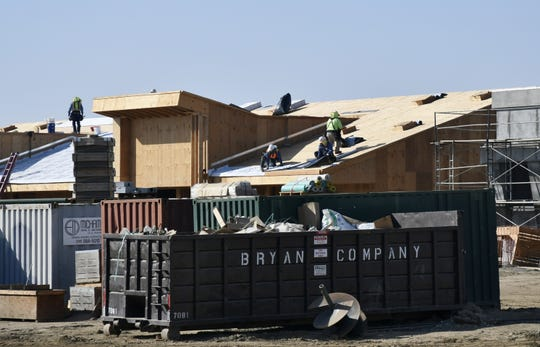 Construction crews work at Visalia Unified School District's new elementary school site on the corner of Ferguson Avenue and Denton Street on Monday, October 22, 2018.