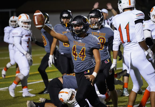 Tulare Union's Elijah Kauvaka celebrates a play against Porterville during their football game on Thursday at Bob Mathias Stadium in Tulare.