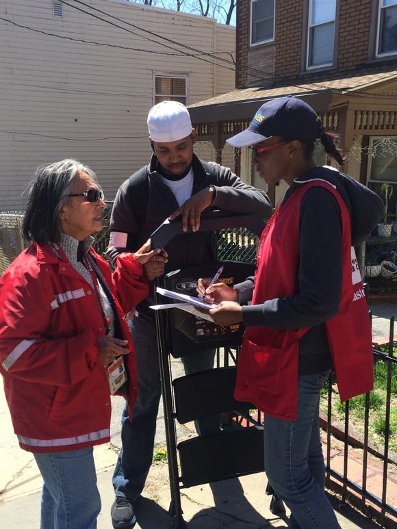 Michelle Nicholas surveying Mount Vernon with fellow Red Cross volunteers to determine which residents needed fire alarms.