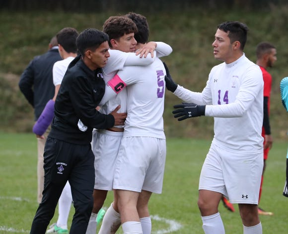 New Rochelle players celebrate after winning on penalty kicks to advance past North Rockland in a Class AA quarterfinal at North Rockland Oct. 20, 2018.