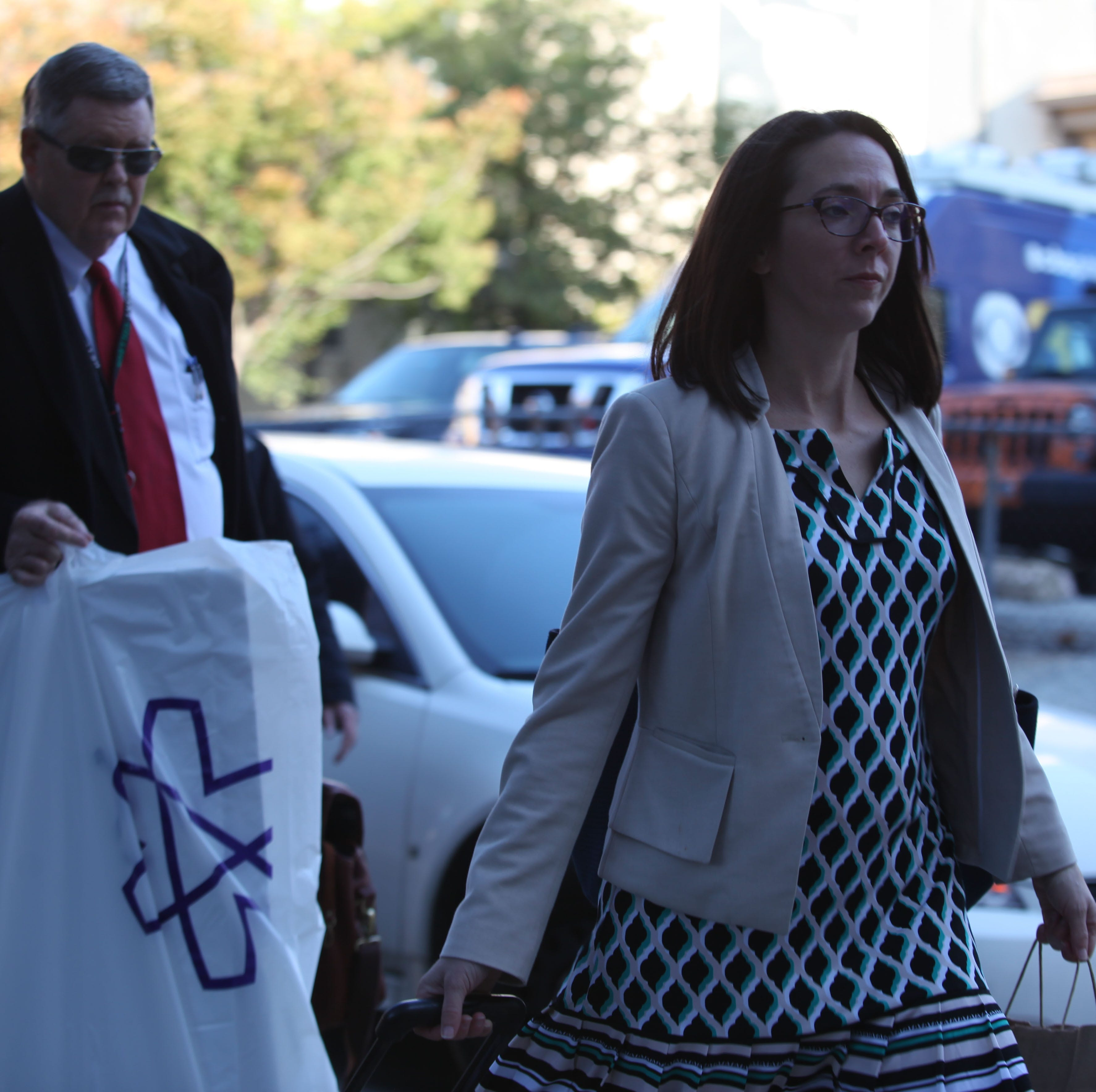 John Downs (left) and Nicole Warner (right), both Deputy Attorney Generals, arrive at the New Castle County Courthouse Monday morning.