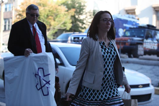 John Downs (left) and Nichole Warner (right), both Deputy Attorney Generals, arrive at the New Castle County Courthouse Monday morning.