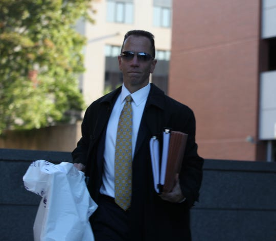 Deputy Attorney General Brian Robertson walks into the New Castle County Courthouse Monday morning.