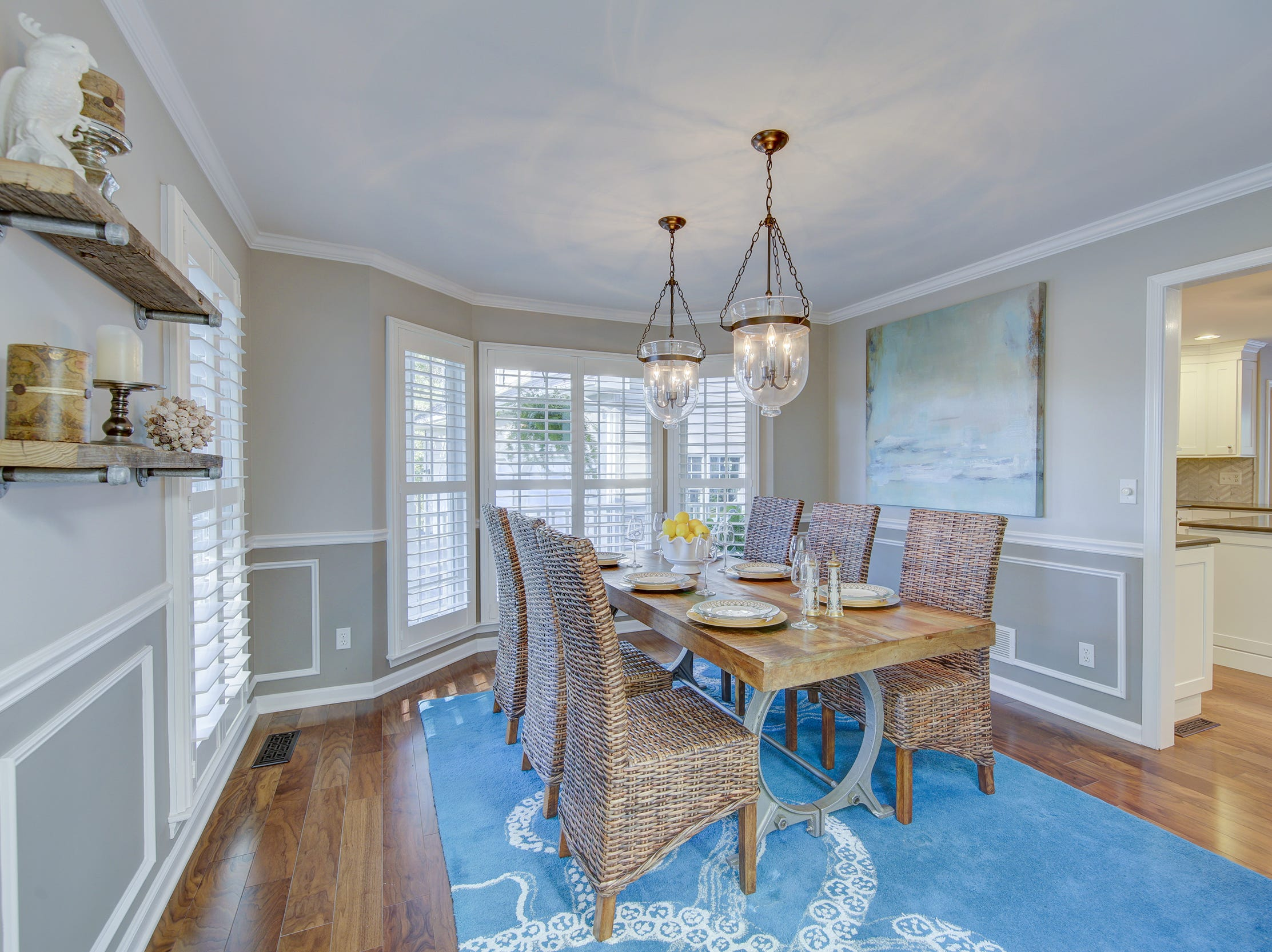 The formal dining room at 204 Lakeview Shores features decorative moldings.