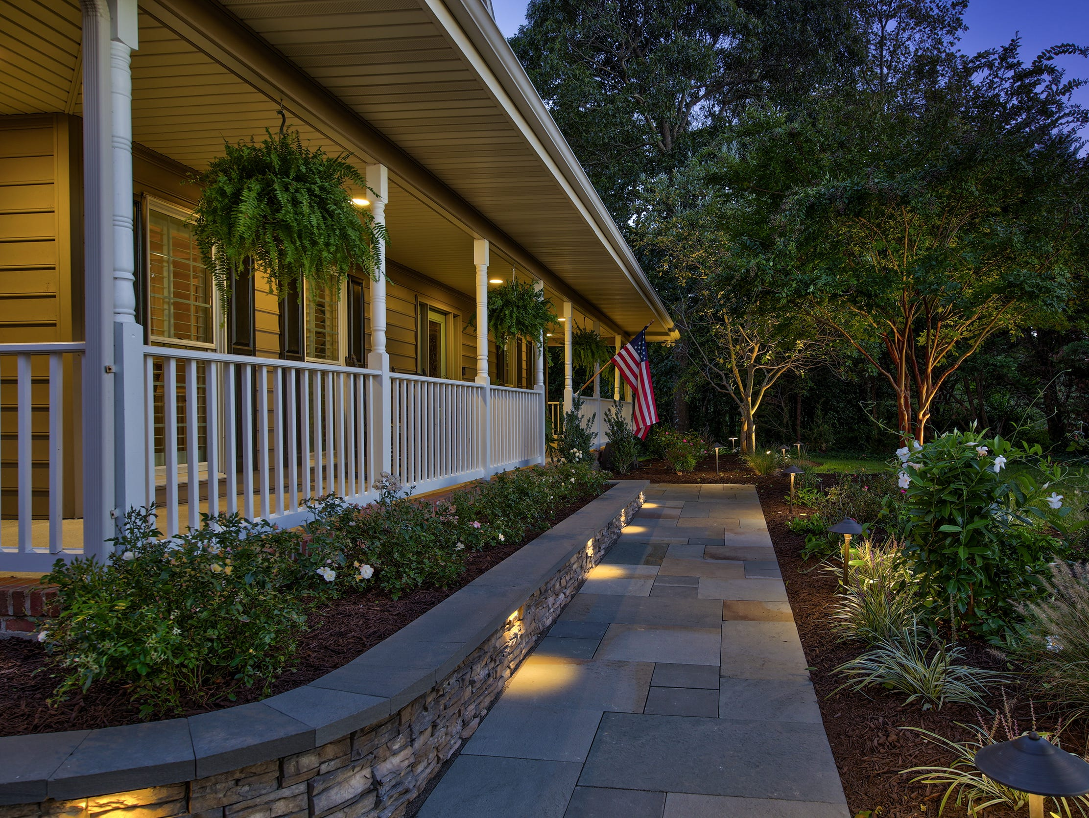 The house at 204 Lakeview Shores features a wrap-around porch, lighted stone walkways and newly redone driveway.
