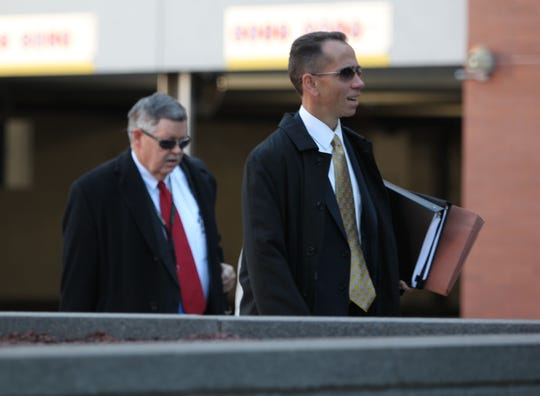 Deputy Attorneys General John Downs (left) and Brian Robertson (right) arrive for the first day of a trial of four prisoners allegedly involved in last year's deadly prison riot at the James T. Vaughn Correctional Center.