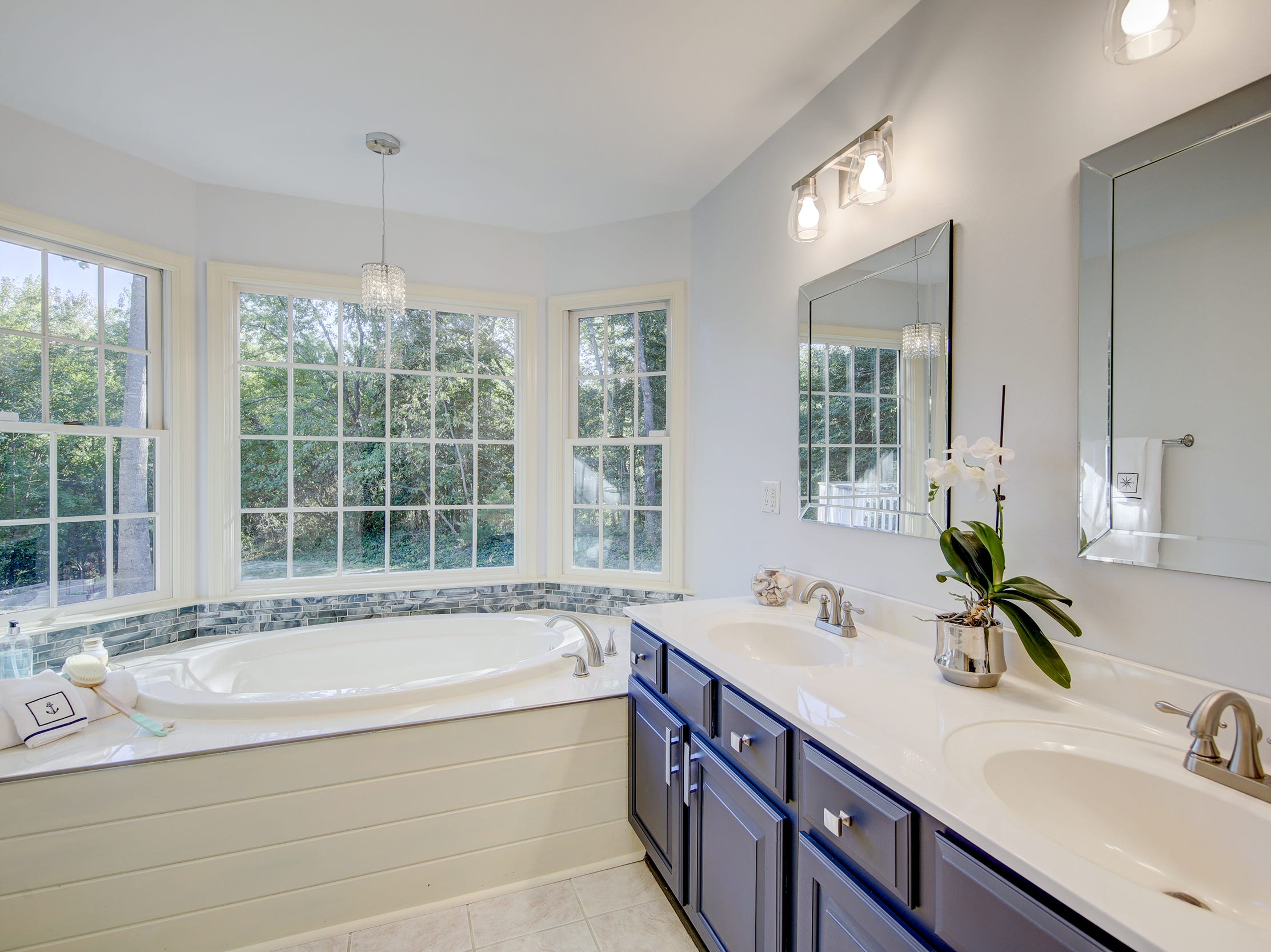 The master bath at 204 Lakeview Shores in Rehoboth Beach features dual vanities and a whirlpool tub.