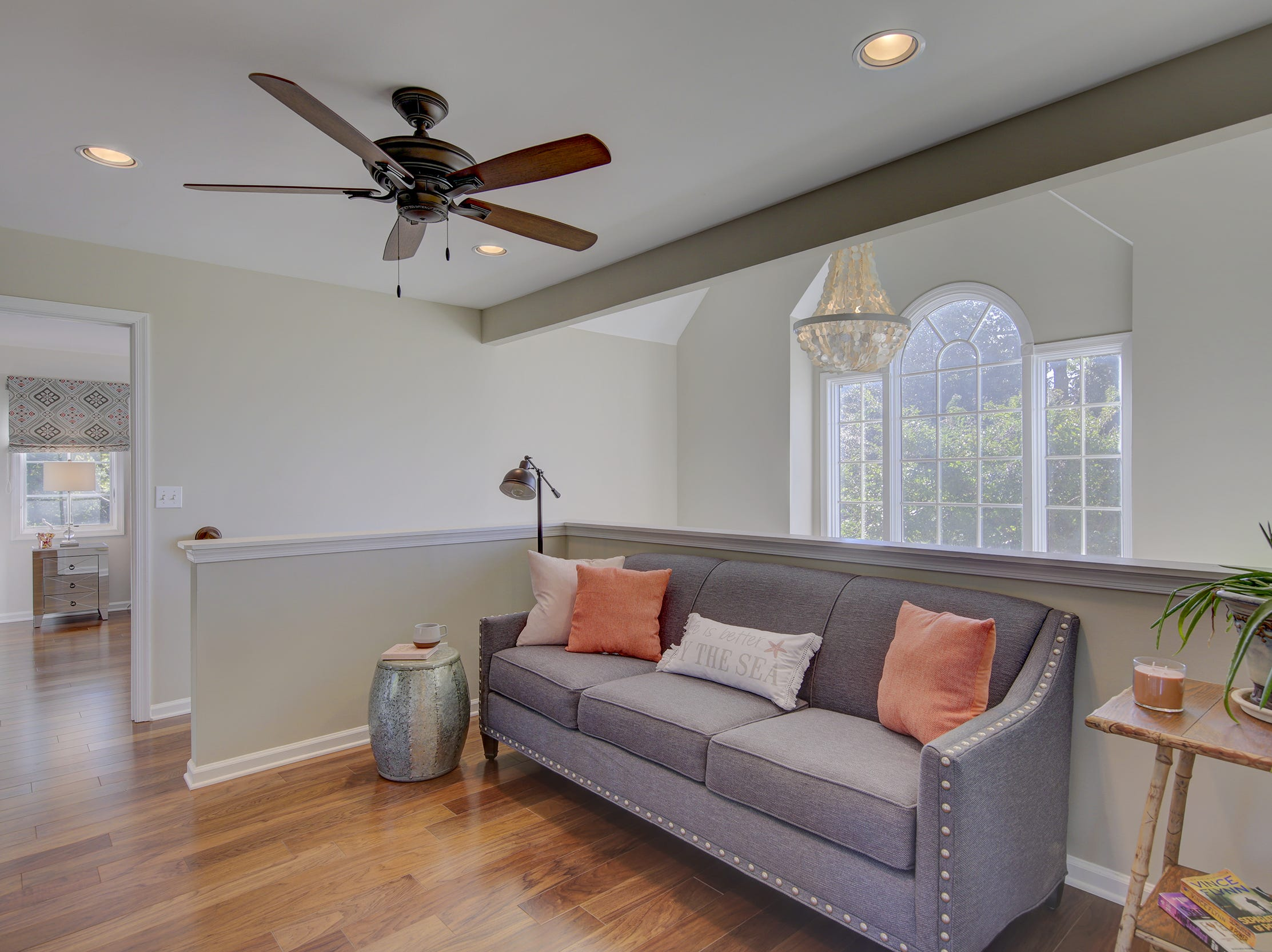 A second floor landing at 204 Lakeview Shores in Rehoboth Beach is large enough to accommodate a seating area.