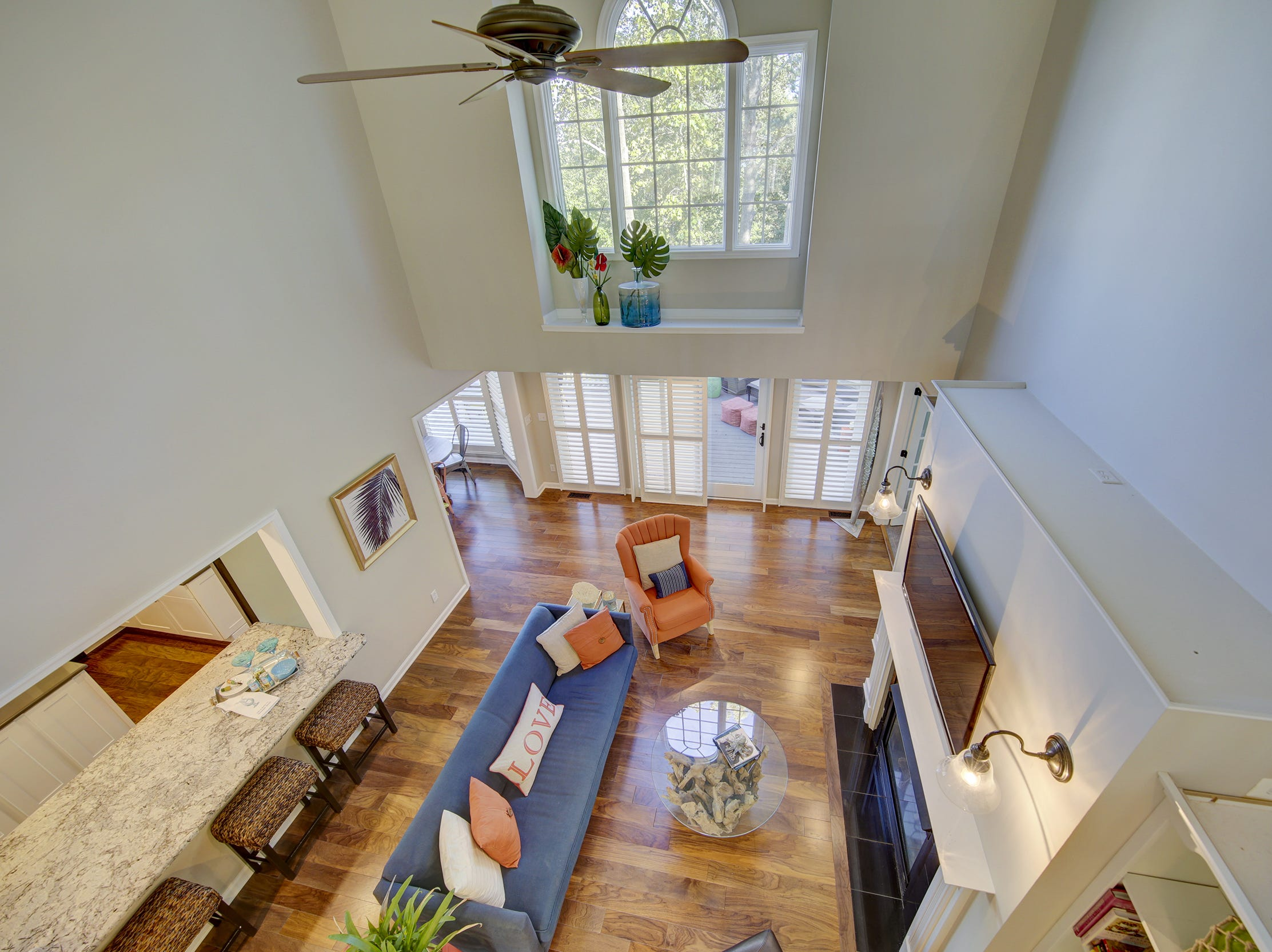 The gathering room at 204 Lakeview Shores in Rehoboth Beach is two stories tall and adjoins the kitchen and a screened porch.
